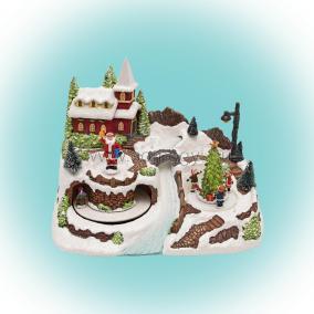 Dioráma karácsonyi falu, mozgó szánnal, mikulással gyermekekkel