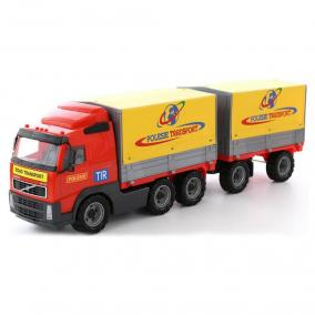 Volvo ponyvás pótkocsis teherautó